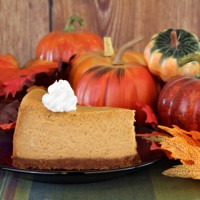 Pumpkin cheesecake in autumn setting