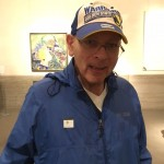 Our resident's Golden State Warriors cap complimenting the bright colors of the Klimt painting behind him.