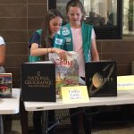 Piedmont Girl Scouts preparing for their book drive presentation to the residents of Bayside Park.